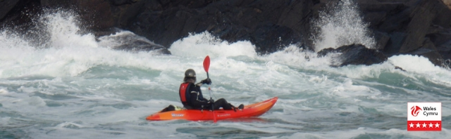Kayak and the r waterspouts around Pembrokeshire
