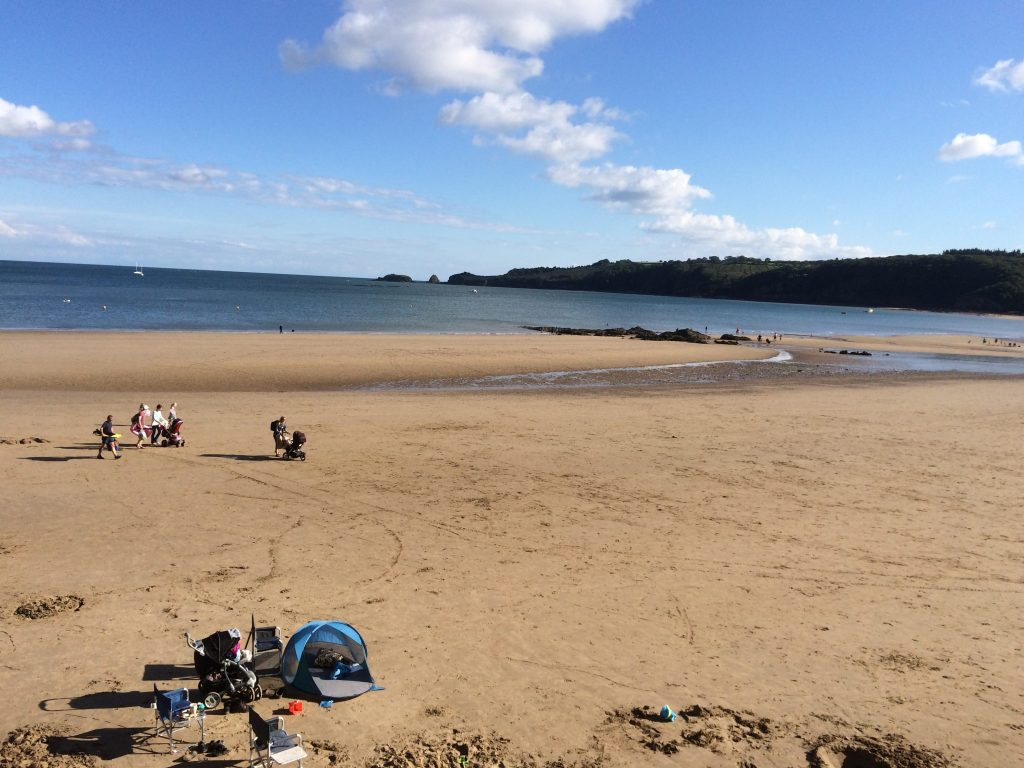 View of a quiet Saundersfoot beach on a hot bank holiday weekend